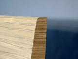 Particolare testiera letto curva legno post formata